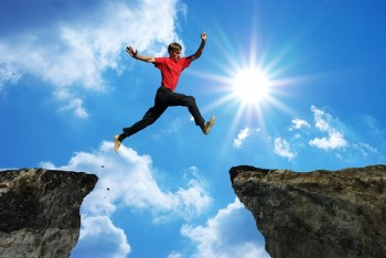 Image of man leaping across a gap.